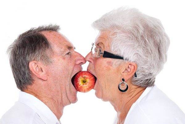 Description: Image result for elderly Biting into an apple